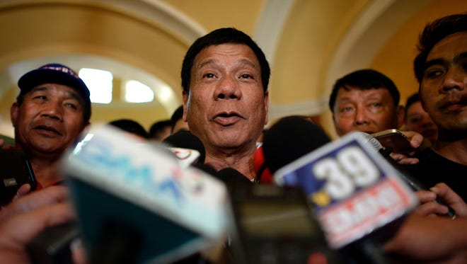 This file photo taken on March 2, 2016, shows Davao City Mayor and Presidential Candidate Rodrigo Duterte speaks to reporters during his campaign sortie in Lingayen, Pangasinan, north of Manila.