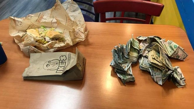 An off-duty Salinas police officer located a man suspected of robbing a bank after seeing him sitting at a table with a sandwich and a large sum of money Monday night.
