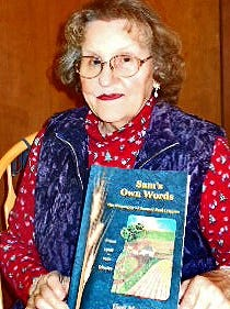 """Gail Mazourek of Danby holding her newly published historical biography, """"Sam's Own Words."""""""