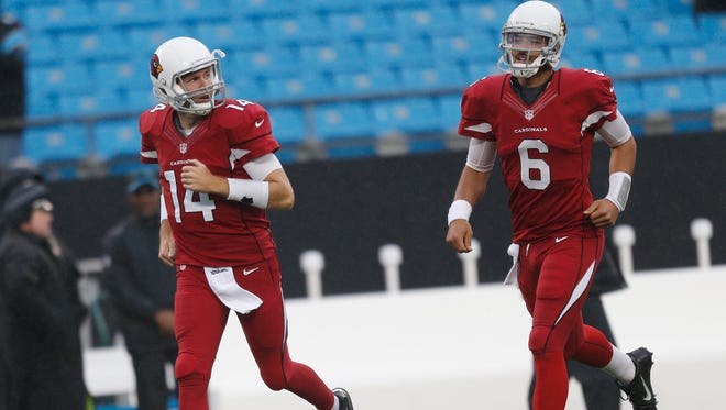 Cardinals QB Ryan Lindley and Logan Thomas take the field for warm ups before playing against the Carolina Panthers in the NFC Wild Card Playoffs at Bank of America Stadium in Charlotte, NC January 3, 2015.