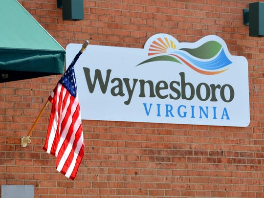 A sign on the side of the building at 301 West Main Street in downtown Waynesboro on Tuesday, June 25, 2013.