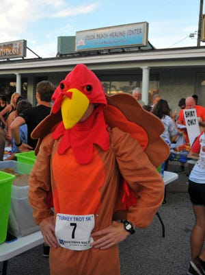 The 2016 Cocoa Beach Turkey Trot had over 1,900 runners and walkers who got up early to start their Thanksgiving Day. Logan Colangelo was incognito as a turkey.
