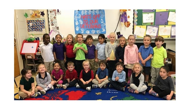As part of a community service day at Cumberland Christian School, pre-kindergarten students made cards, hats and a banner for Vineland's veterans. For school information, visit www.cccrusader.org.