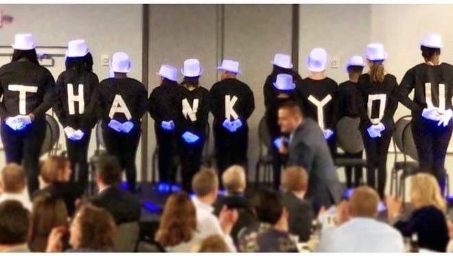 """The Boys & Girls Club annual Reach for the Stars banquet featured a """"white glove"""" performance by a group of club members."""