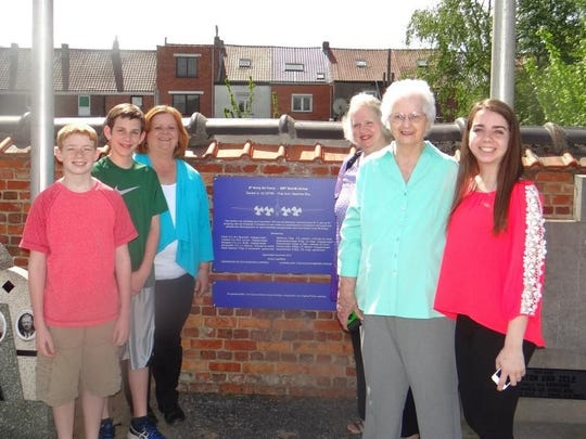 Family gathers at the commemorative plaque in the Lokeren