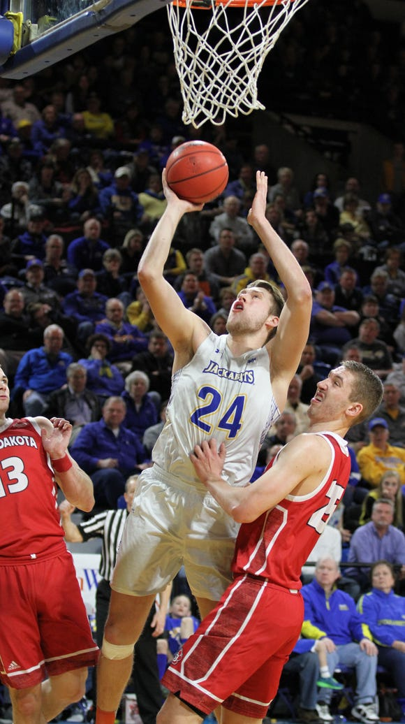 South Dakota State's Mike Daum (24) scores in the paint