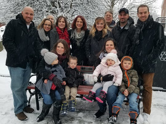 Three generations of the Milroy family are shown Dec. 9 with the bench in front of the Rhinebeck Post Office dedicated to the late Robert Milroy, who walked the village mail route for more than three decades. The family gives special thanks to the Rotary Club of Rhinebeck for permitting the bench dedication.