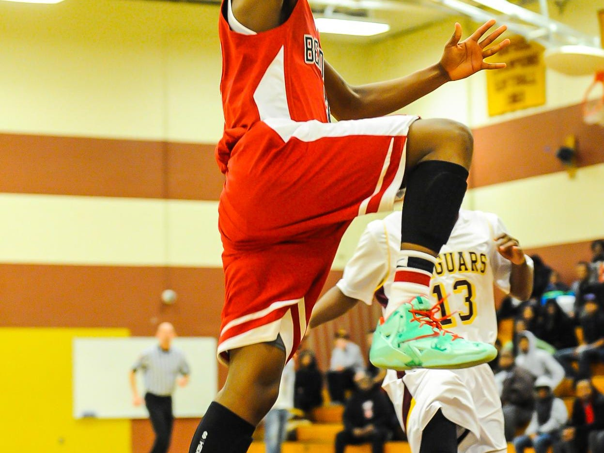 Jorden Duffy goes airborne to the basket at Washington High.