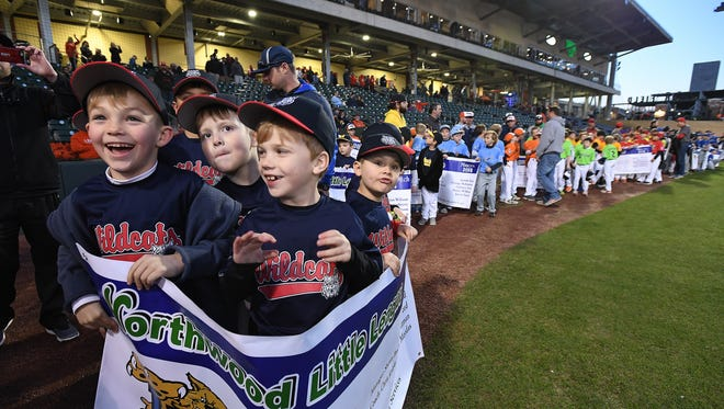 Members of the Northwood Little League coaches pitch Wildcats, from left, Bryce Glunt, Stone Aultman, and Evan Bradley take part in the 50th Anniversary Opening Night festivities at Fluor Field on Wednesday, March 8, 2018.