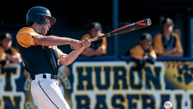 Port Huron Northern's Austin Howard gets a hit during a district baseball game Friday, June 3, 2017 at Port Huron Northern High School.