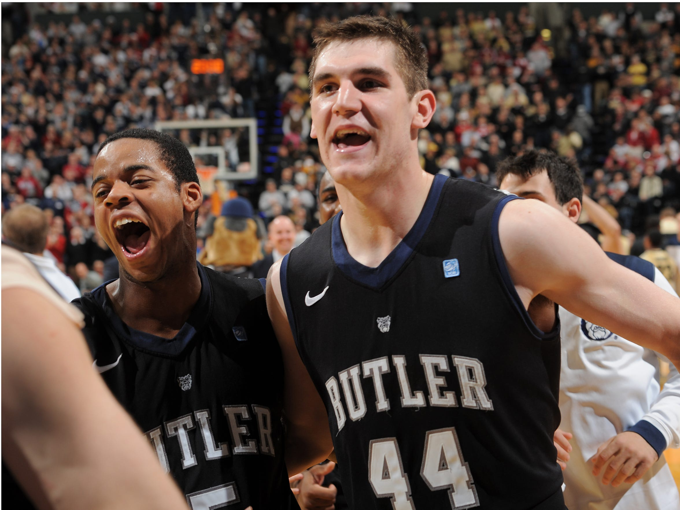 Butler's Andrew Smith celebrates with Ronald Nored, left, after defeating Purdue in the Crossroads Classic in 2011.