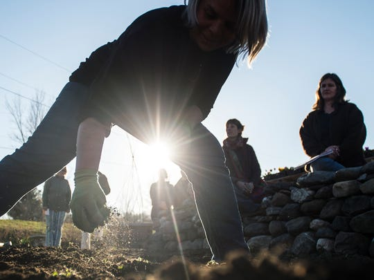Julie Rubaud, owner of Red Wagon Plants on Shelburne Falls Road in Hinesburg, shows how to space early plantings of a cold hardy vegetable variety during her kitchen garden workshop.
