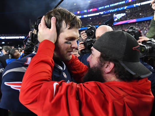 Jan 21, 2018; Foxborough, MA, USA; Patriots quarterback Tom Brady greets defensive coordinator Matt Patricia after defeating the Jaguars in the AFC Championship Game at Gillette Stadium.