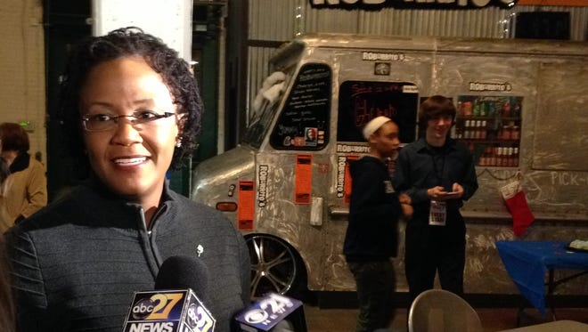 York Mayor Kim Bracey speaks to reporters Thursday at Central Market after unveiling the city's 275th anniversary celebration events happening throughout 2016.