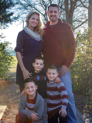 New Fairview Chamber president Erica Kelley with her husband and their three sons.