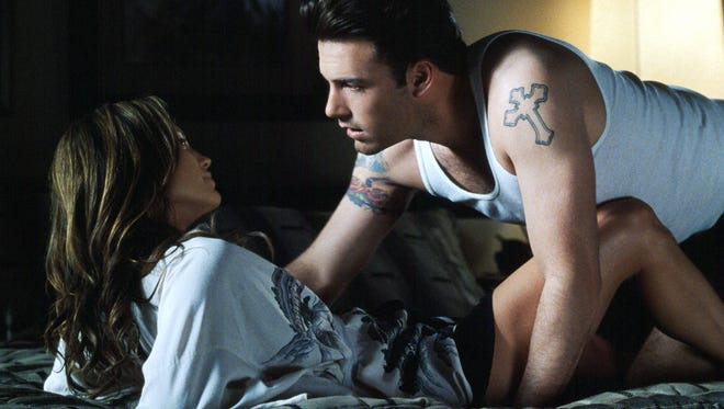 Jennifer Lopez and Ben Affleck get close in 'Gigli.' The movie may not have been a hit but who could take their eyes off of these beautiful people?
