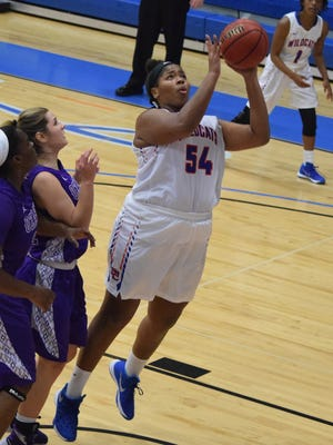 Louisiana College's Brooke Jones (54, right) scores two over University of the Ozarks defenders Thursday.