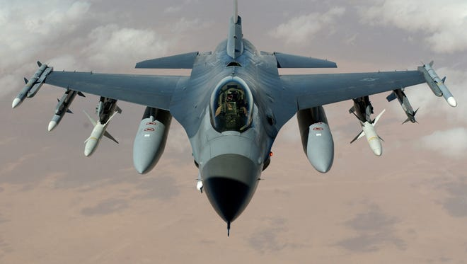 A U.S. Air Force F-16 Fighting Falcon flies a mission in the skies near Iraq on March 22, 2003 during Operation Iraqi Freedom.