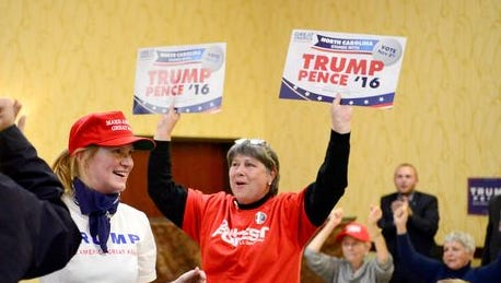 Gail Mitchell, center, celebrates at the Buncombe County Republican Party's gathering Tuesday night as Fox News announces Donald Trump won North Carolina.