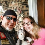 Tony Ruiz and Greater Lafayette resident Brittney Bushman pose with Ruiz's stuffed donkey. The donkey has been missing since Memorial Day.