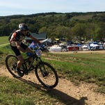 A mountain biker navigates one of the many riding trails at Two Rivers Bike Park.