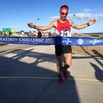 Grand Ledge graduate Calum Ramm, running along the board walk in South Beach Miami in his third marathon in three days.
