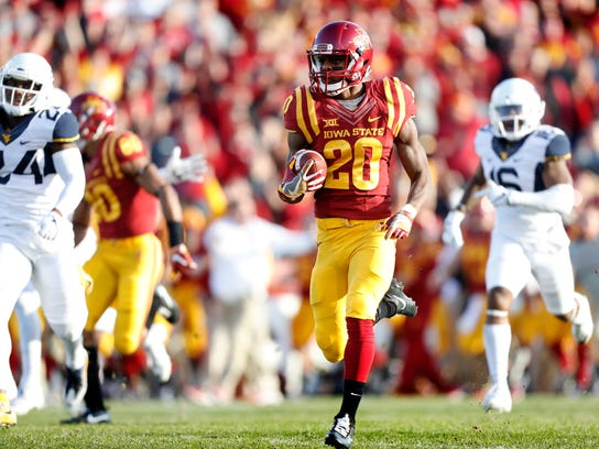 Iowa State's Kene Nwangwu (20) returns a kickoff 97-yards for a touchdown during the first half of an NCAA college football game against West Virginia, Saturday, Nov. 26, 2016, in Ames, Iowa. (AP Photo/Charlie Neibergall)