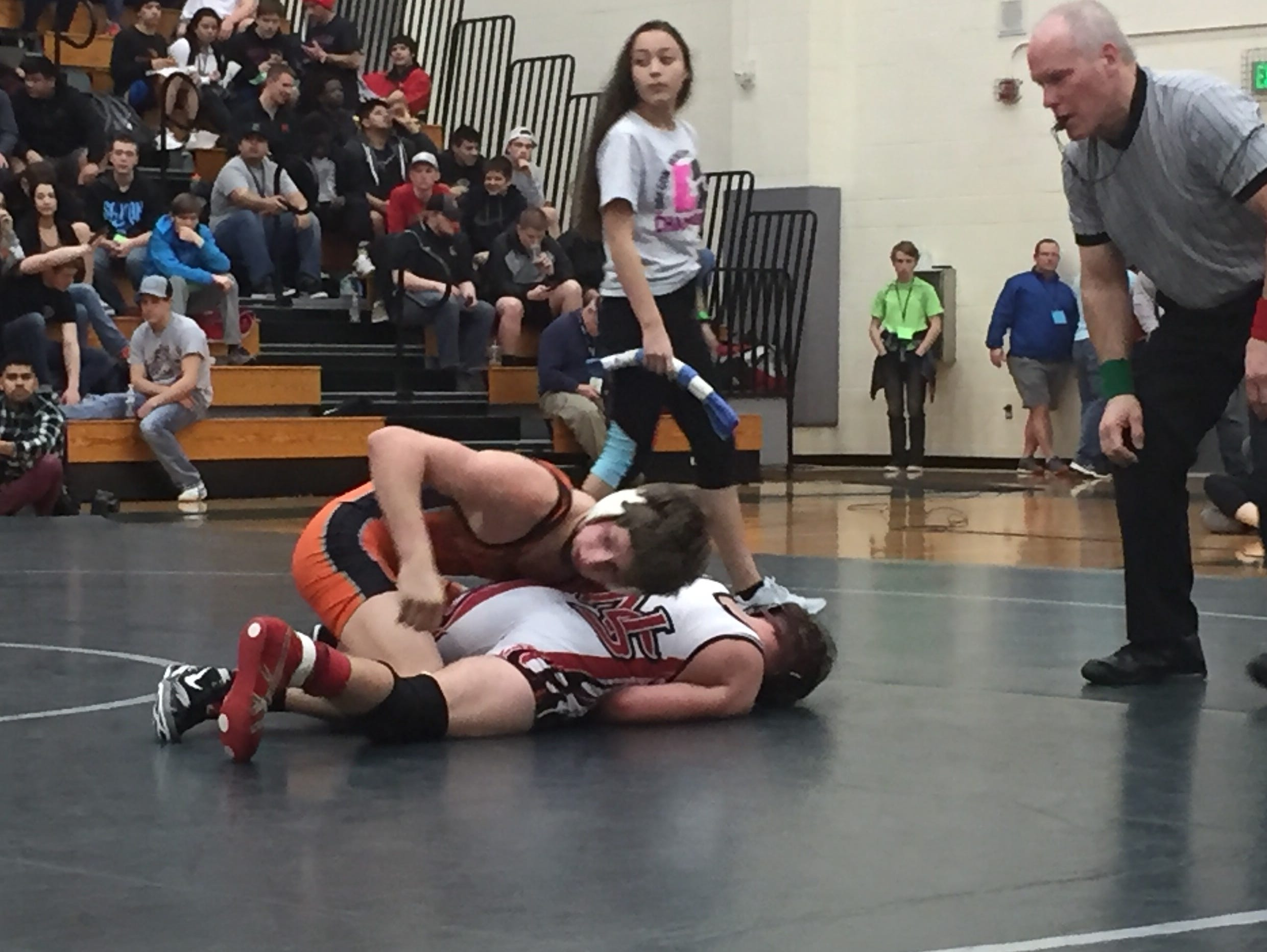 Sprague's Daniel McClung, top), posted a 16-4 decision over North Salem's Shannon Glover in the GVC district championship match at 126 pounds.