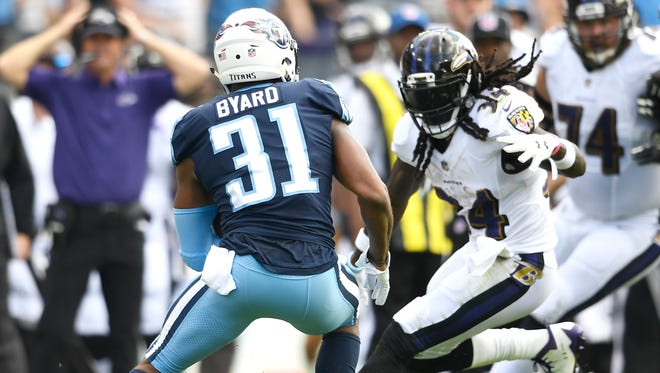 Titans safety Kevin Byard runs up the field with an interception during the first quarter Sunday at Nissan Stadium. It was one of his two picks in the game.