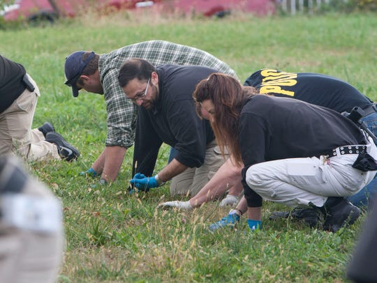 11/5/15 - Investigators search for clues in the Asbury