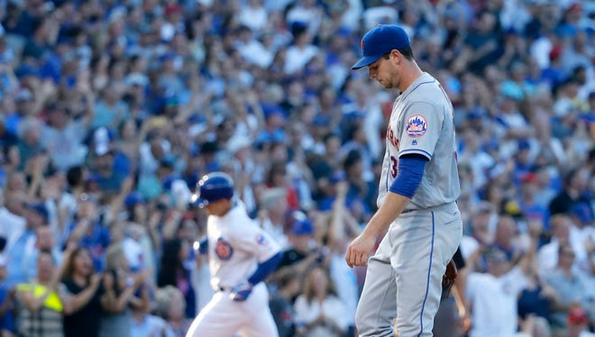 Mets starting pitcher Steven Matz, right, returns to the mound after giving up a three-run home run to Chicago Cubs' Anthony Rizzo, left, during the third inning of a baseball game Monday, July 18, 2016, in Chicago. Javier Baez and Kris Bryant also scored on the play.