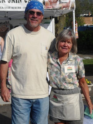Donna Bednar shares a happy moment with one of many vendors at Loveland Farmers' Market.