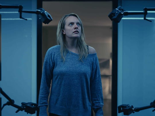 """Cecilia Kass (Elisabeth Moss) peeks at her ex's high-tech handiwork in """"The Invisible Man."""""""