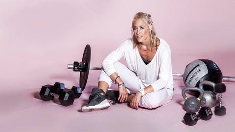 """This undated photo shows fitness trainer Lacey Stone. Stone is a tough-as-nails trainer with a heart of gold. The Los Angeles-based Flywheel instructor was recently chosen as one of the trainer's for Khloe Kardashian's new show """"Revenge Body."""""""
