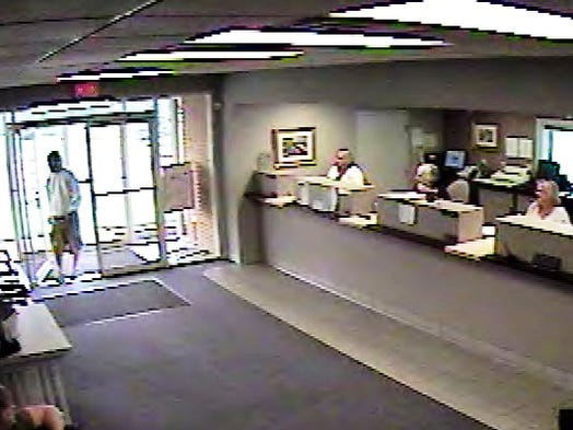 The suspect wanted for robbing the Carters Bank & Trust in Weyers Cave July 29, 2014 is described as a white male in his mid 20s, about 5 feet, 11 inches tall and weighing about 170 pounds. He was wearing carpenter-style khaki shorts and a gray sweatshirt with a hood pulled over a red baseball cap, a red undershirt and tan Nike tennis shoes. Witnesses said he had blue eyes and some dark facial hair, the sheriff's office said.