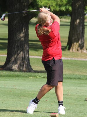 United's Paige McKeown tees off on No. 1 at Gibson Woods in Monmouth on Tuesday afternoon in a dual against Princeville.