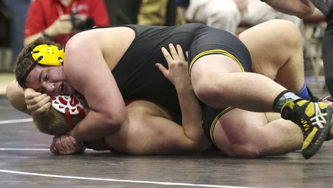 Southeast Polk's Jake Marnin, pins Council Bluffs Ambraham Lincoln's Jordan Bywater during their Class 3-A 285-lbs quarterfinal match at the 2014 IHSAA State Wrestling Tournament Friday Feb. 21, 2014, at Wells Fargo Arena in Des Moines, Iowa.(Rodney White/The Register)
