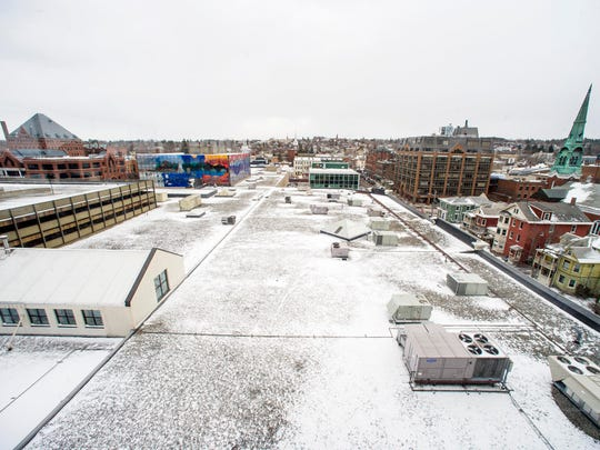 The site of the proposed Burlington Town Center is seen from the seventh floor of 100 Bank Street looking east in Burlington on Thursday, March 9, 2017. Developer Don Sinex plans to replace the two-story mall and parking lot with a 14-story housing, parking and business block between Pine and St. Paul streets.