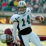 Montana State's Travis Lulay scrambles for yardage against the Montana Grizzly defense in 2004.