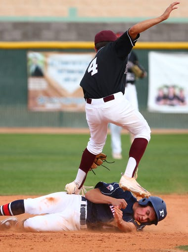 Pinnacle High's Griffin Hamel (7) slides safely into second base under the tag by Hamilton High's Dustin Bermudez (4) in the 3rd inning on Mar. 7, 2018 in Chandler, Ariz.