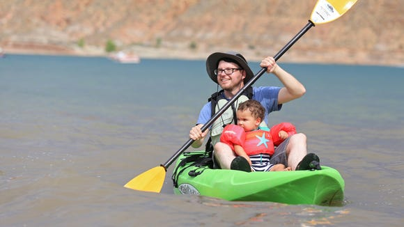 Outdoors writer Brian Passey kayaks with his nephew, Vale Munson, at Quail Creek Reservoir State Park in Hurricane.