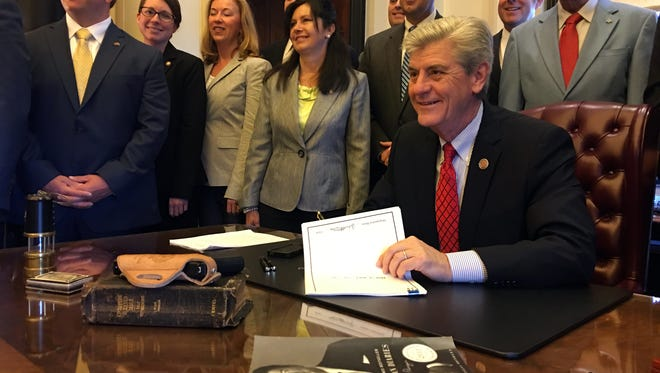 Gov. Phil Bryant signs the Church Protection Act to allow churches to legally have armed security.