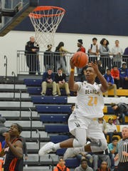 Battle Creek Central's Cyntell Williams drives the basket Tuesday night.