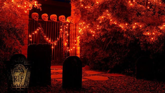 Trick-or-treaters are faced with many scary obstacles before receiving candy at Roger Naylor's house.
