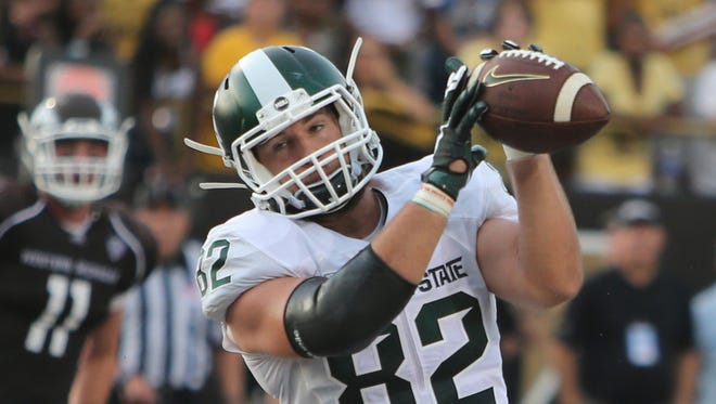 Michigan States tight end Josiah Price catches a touchdown against Western Michigan at Waldo Stadium in Kalamazoo on Sept. 4, 2015.