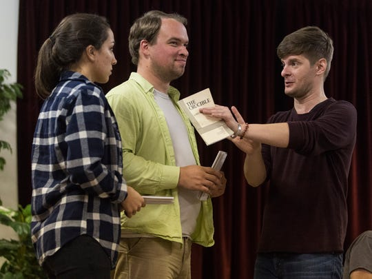 Emily Durchholz (left to right) and Brent Bredhold receive feedback from Kevin Roach, Art Director of the Evansville Civic Theatre, during a play rehearsal for The Crucible at First Avenue Presbyterian Church in Evansville, Ind., on Wednesday, Sept. 13, 2017. Roach is recovering from surgery after donating a kidney to his cousin-in-law.