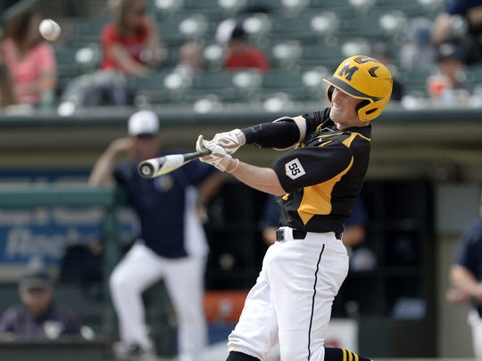 McQuaid's Tyler Griggs connects with a pitch during the Section V Class AA championship game at Frontier Field, Saturday, May 26, 2018. No. 1 seed Victor won the Class AA title with a 3-2 win over No. 2 seed McQuaid.