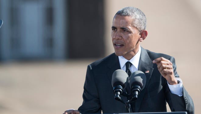 President Barack Obama speaks on the 50th anniversary of Bloody Sunday at the foot of the Edmund Pettus Bridge in Selma, Ala.