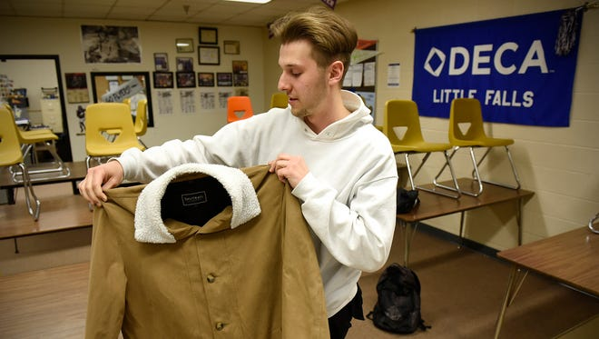 Jacob Waldock of Little Falls talks about one of his clothing designs Thursday at Little Falls High School. Waldock received third place in the national FIDM/DECA fashion contest.