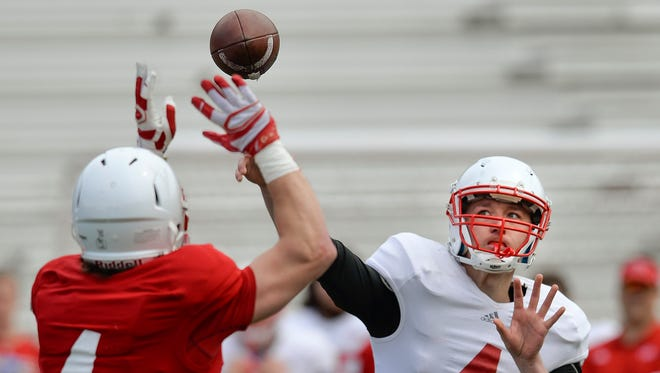 St. John's quarterback junior Matt Miedtke (4, right) gets his pass blocked by junior linebacker Joe Robel in the first half of the spring Red/White game Saturday, April 30, at Clemens Stadium.